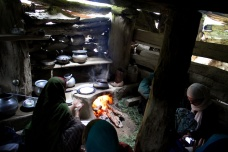 Chai and chapatis being cooked inside a Gujjar hut, Kashmir