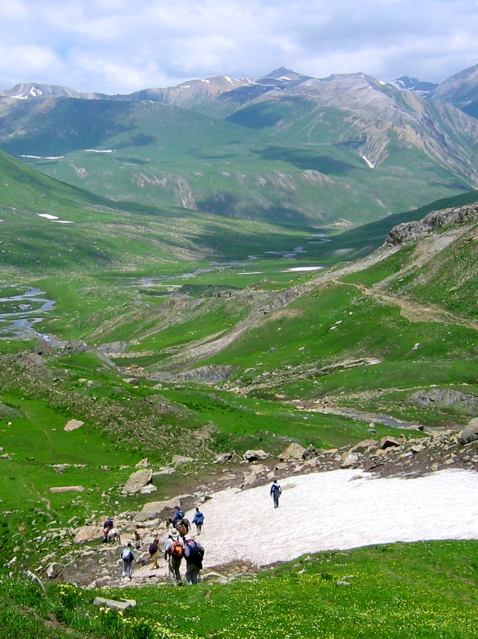 Descending Nichinai Pass toward Vishansar Lake on a trek in Kashmir